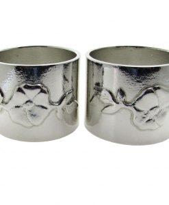 A pair of wild rose motif napkin rings cast in Cornish tin